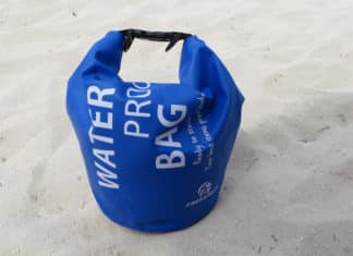 Dry bag sitting in sand